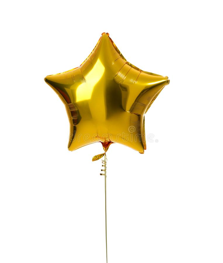 Single gold big star metallic balloon object for birthday royalty free stock photography
