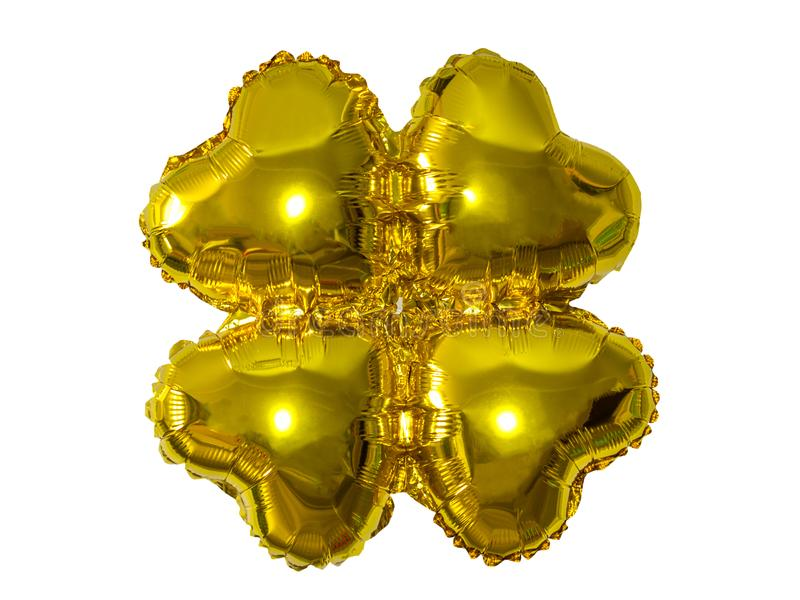 Single gold foil Four-leaf clover balloon object for birthday party stock images