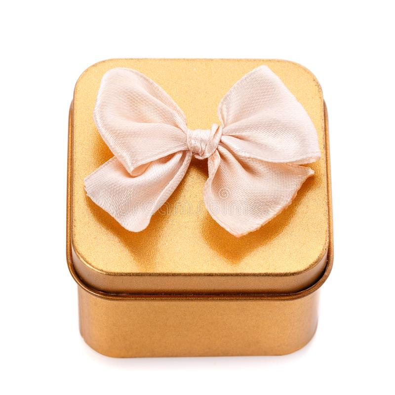 Single gold gift box with bow isolated stock photography