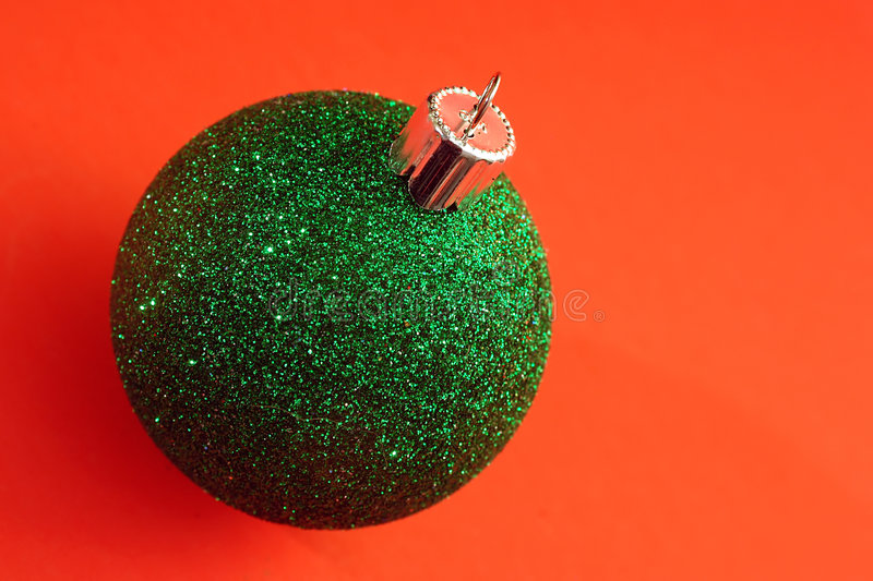 A single green Christmas Ornament royalty free stock image
