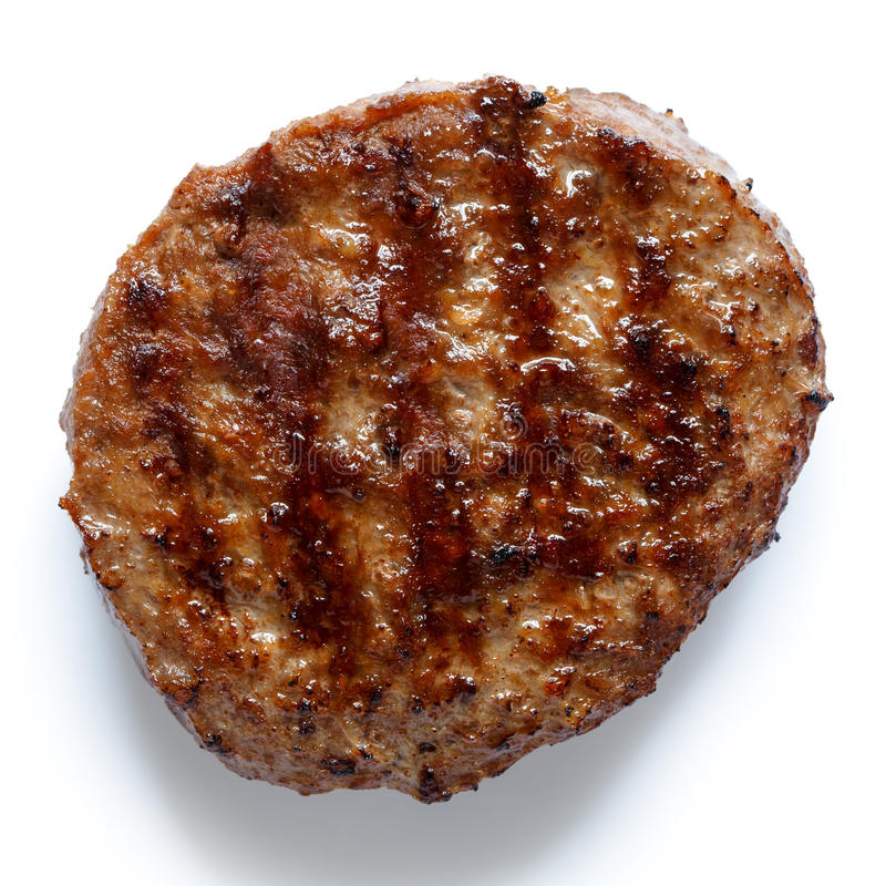 Single grilled hamburger patty on white from above. royalty free stock photo