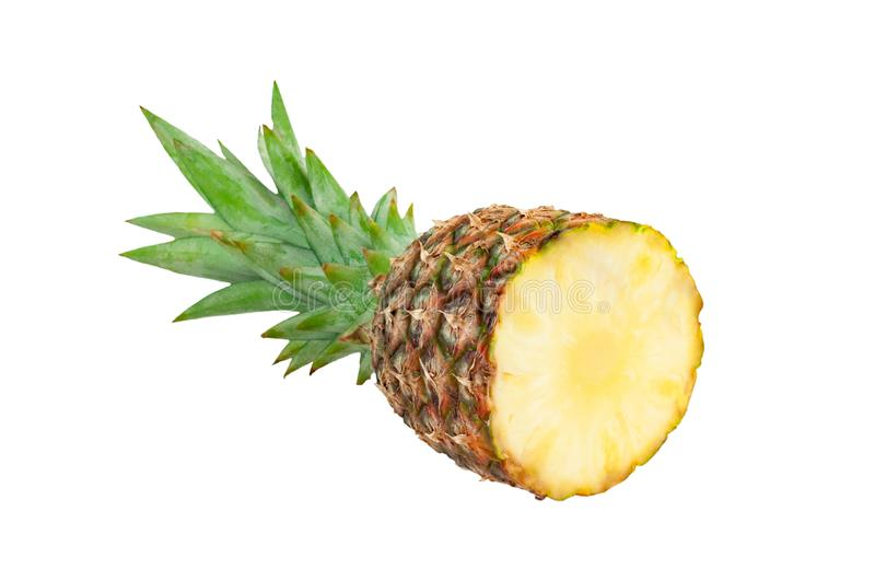 Single half of whole fresh ripe pineapple with green leaves isolated on white stock photos