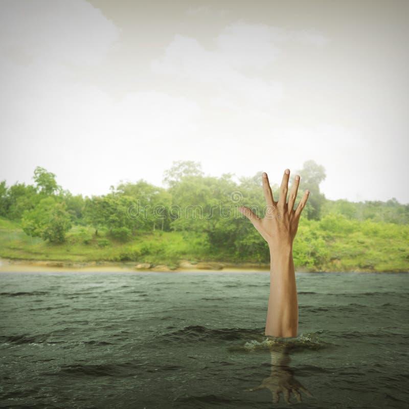 Single hand of drowning man stock photos