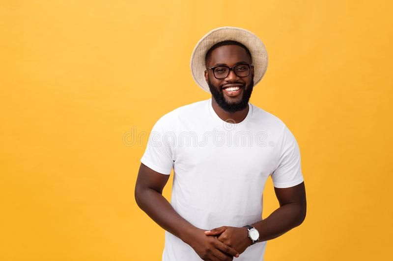 Single handsome muscular Black man with shaved head, folded arms and cheerful expression stock photos