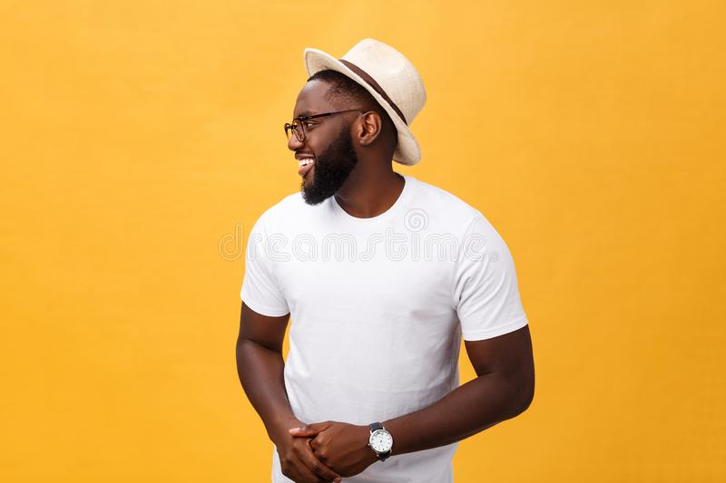 Single handsome muscular Black man with shaved head, folded arms and cheerful expression royalty free stock photography