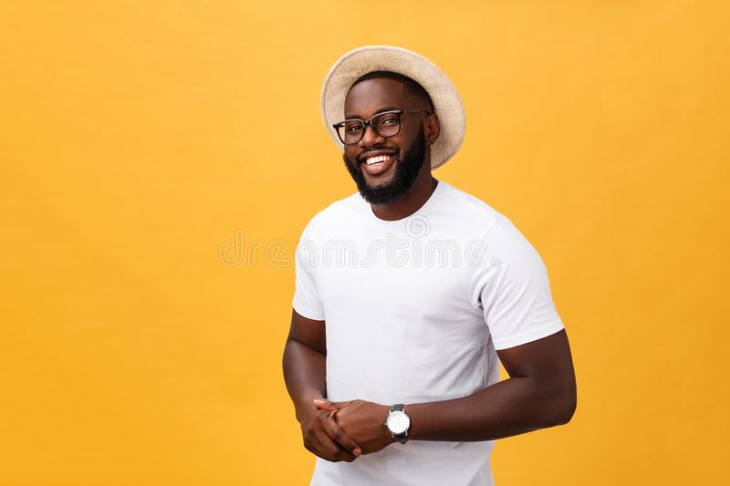 Single handsome muscular Black man with shaved head, folded arms and cheerful expression royalty free stock image