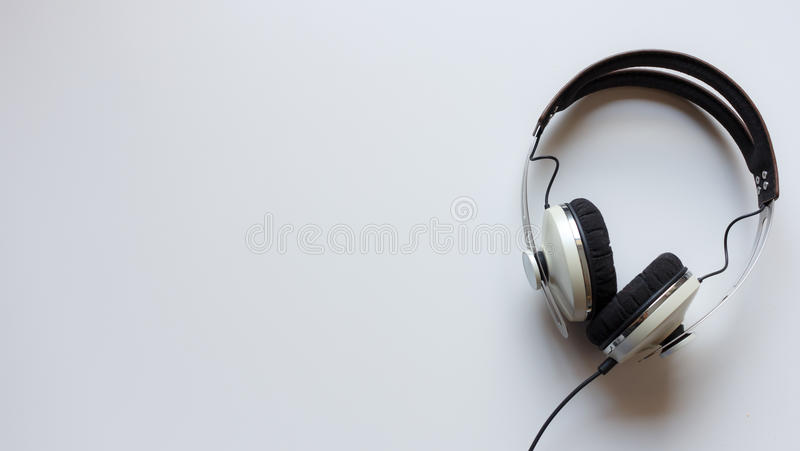 Single headphones on a table. Single headphones on a table stock photo