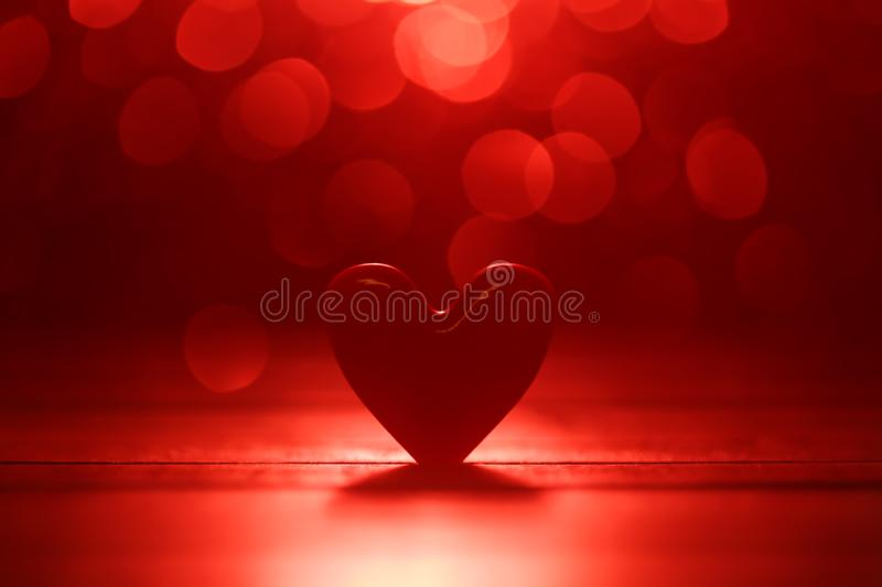 Single heart and red bokeh abstract background. Single heart and on soft red bokeh abstract background royalty free stock images