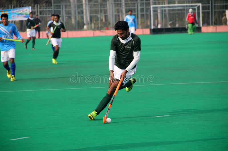 Single Hockey Player. SIALKOT, PAKISTAN - DECEMBER 2014: All Pakistan Annual Field Hockey Tournament Between PIA and PAF Teams at Sialkot International Hockey stock photography