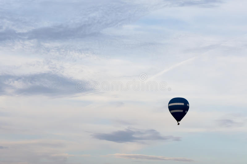 Single hot air balloon against a beautiful summer sky. With peaceful and calming colors stock image