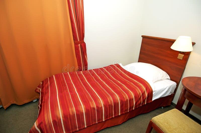 Single hotel bedroom stock photo