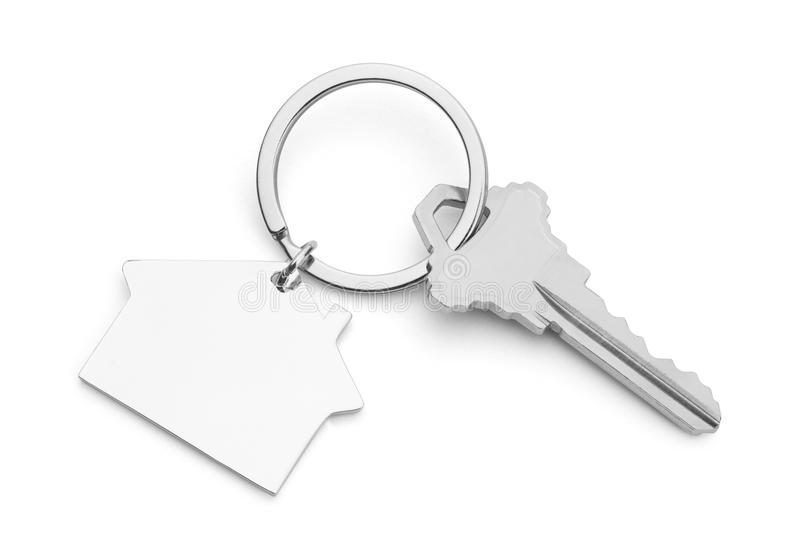 Single House Key. House Key With House Keychain Isolated on a White Background royalty free stock photos