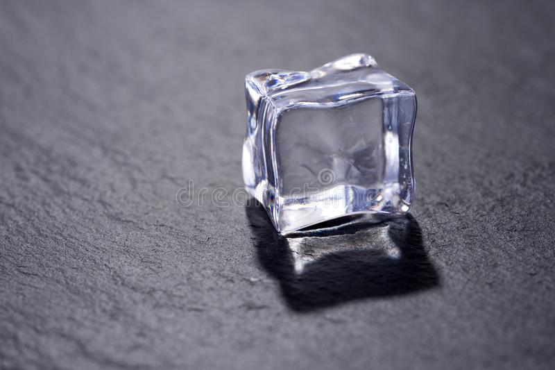 Single ice cube isolated on black stock images