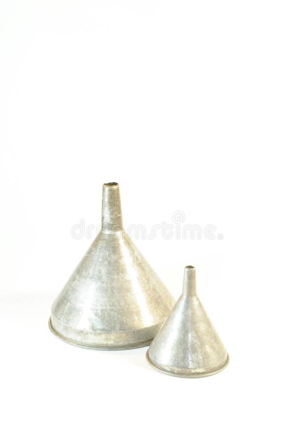 Two of an antique silver funnel royalty free stock photography