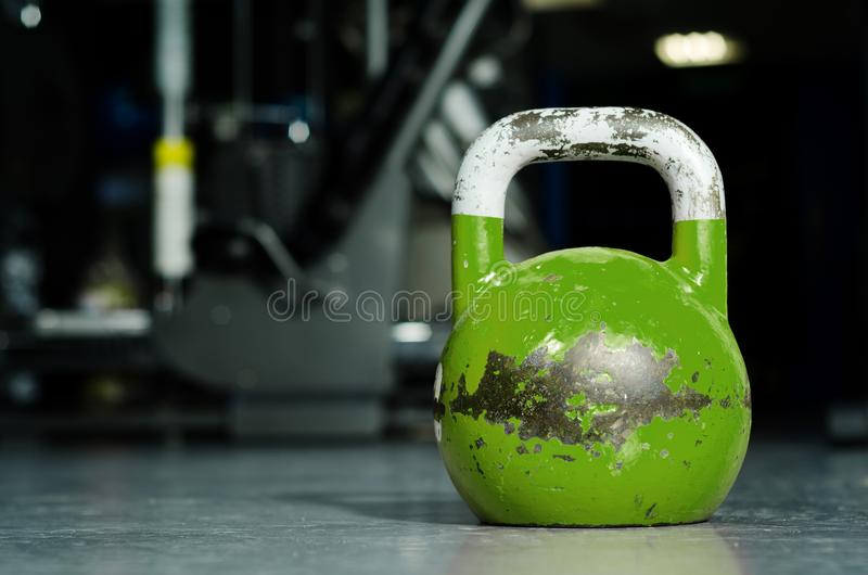 Single kettlebell on the gym floor ready to use for strength and conditioning training sport concept.  stock image