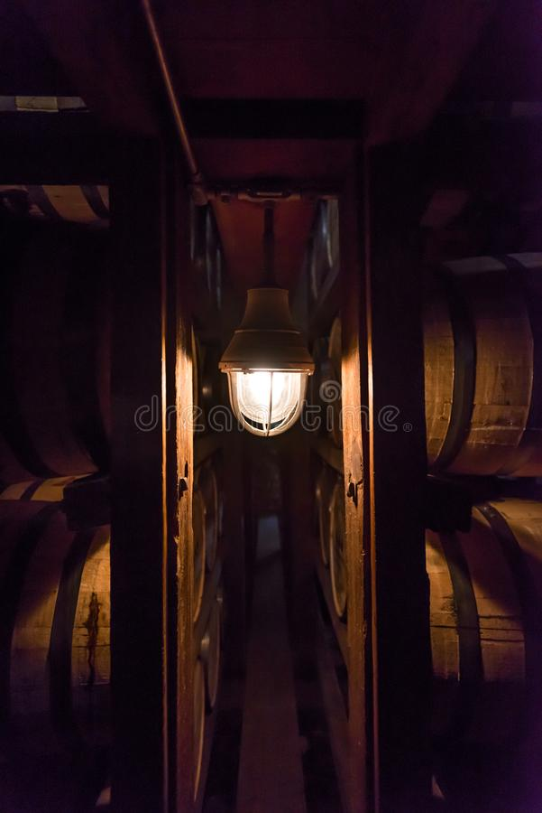 Free Single Lamp In Bourbon Warehouse Royalty Free Stock Image - 101622026