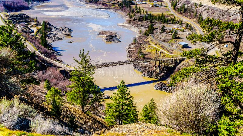 A single lane bridge over the Fraser River at the town of Lillooet, British Columbia, Canada royalty free stock photos
