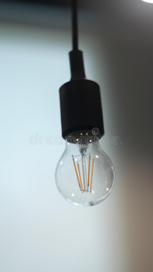 A single light off hanged down lamp in the office. S royalty free stock photography