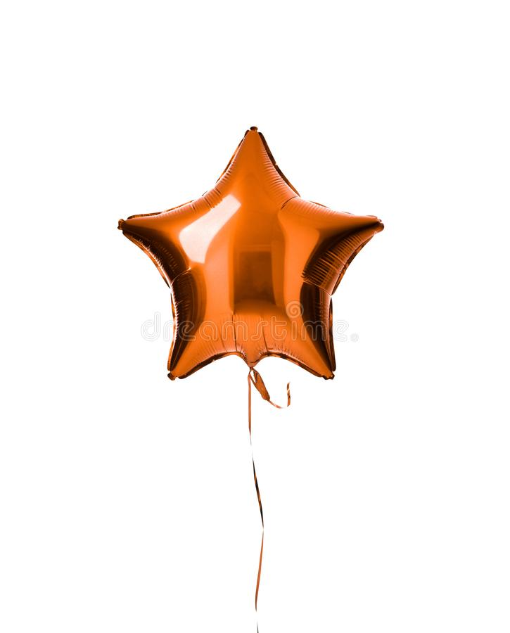 Single light orange color metallic star balloon object for birthday party isolated on a white royalty free stock photography