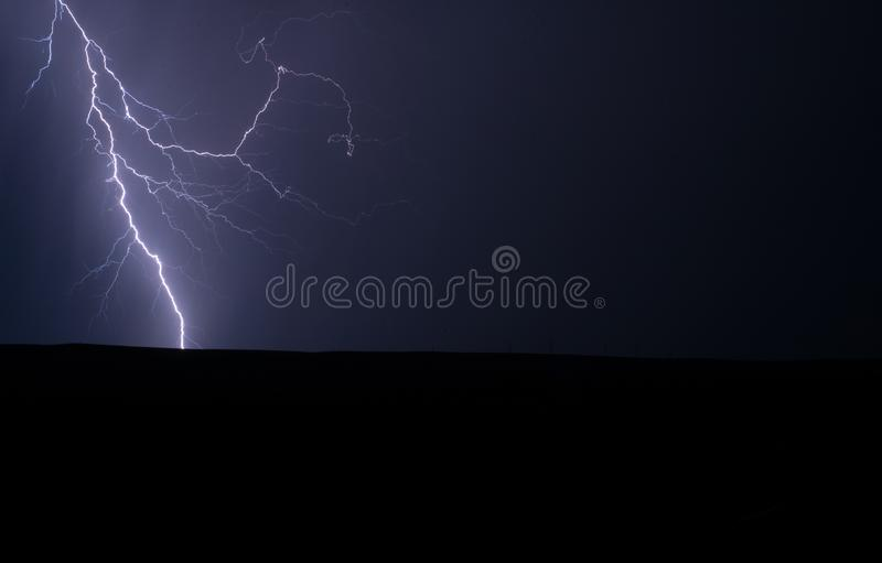 Lightning Strike at Night in Nature royalty free stock images