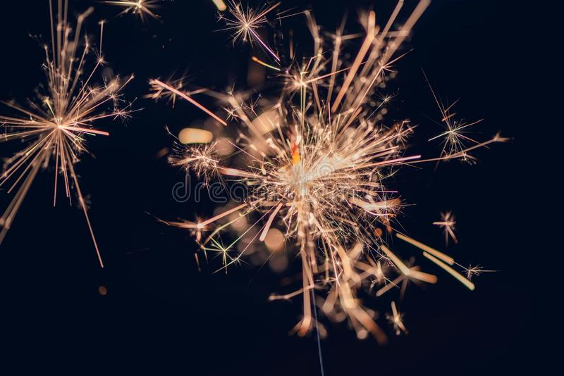 Single little sparkler in front of black background, close up, new year, birthday etc. concept royalty free stock images