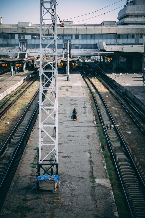 A lonely woman waiting for a train royalty free stock photo