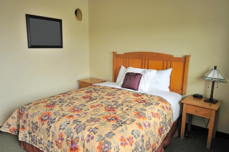 Single luxurious bed. In hotel room. Suitable for concepts such as travel, tourism, vacation and holiday, and relaxation stock photography