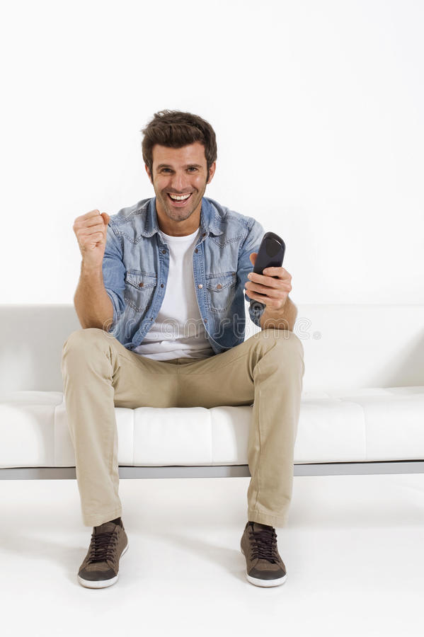 Download Single Man On The Couch Watching TV Stock Photo - Image: 17993356