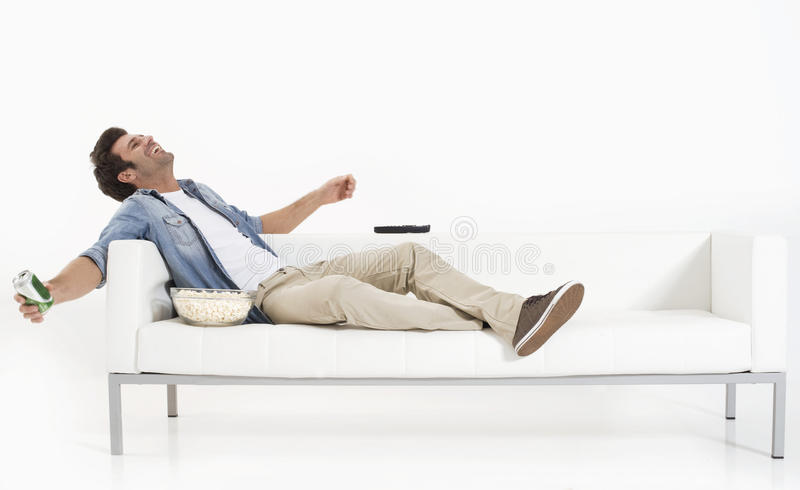 Download Single Man On The Couch Watching TV Stock Image - Image: 17993467