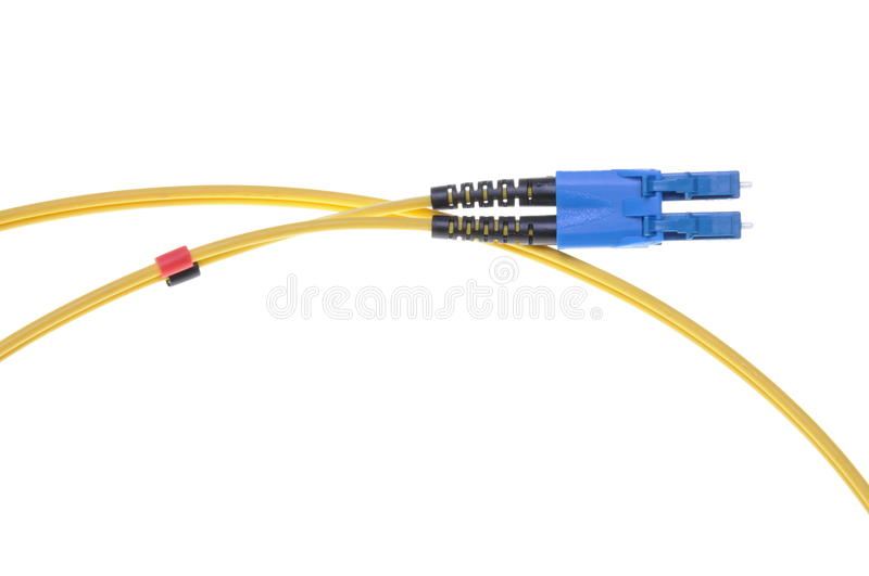 Single mode patch cord LC with blue SC double connector. Isolated on white background stock photo
