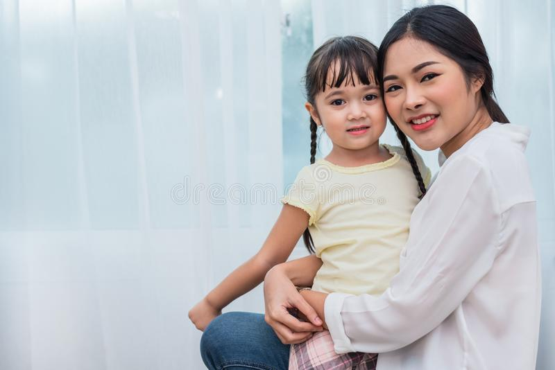 Single mom and daughter portrait. Happy family and people concept. Mother and Children day theme stock image