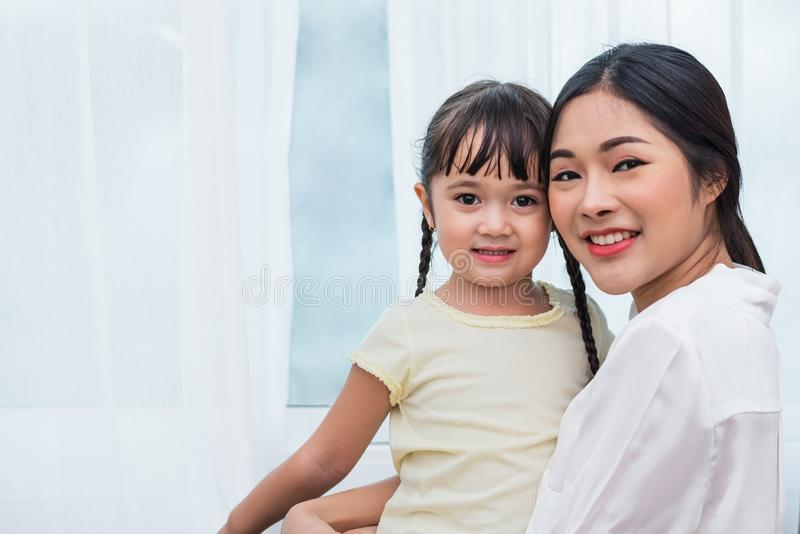 Single mom and daughter portrait. Happy family and people concept. Mother and Children day theme stock photography
