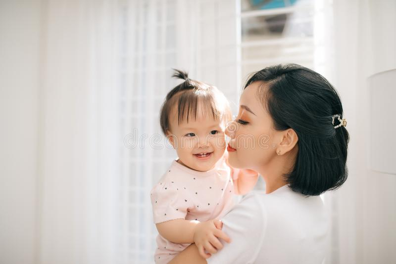 Single mom and daughter portrait. Happy family and people concept. Mother and Children day theme stock photos