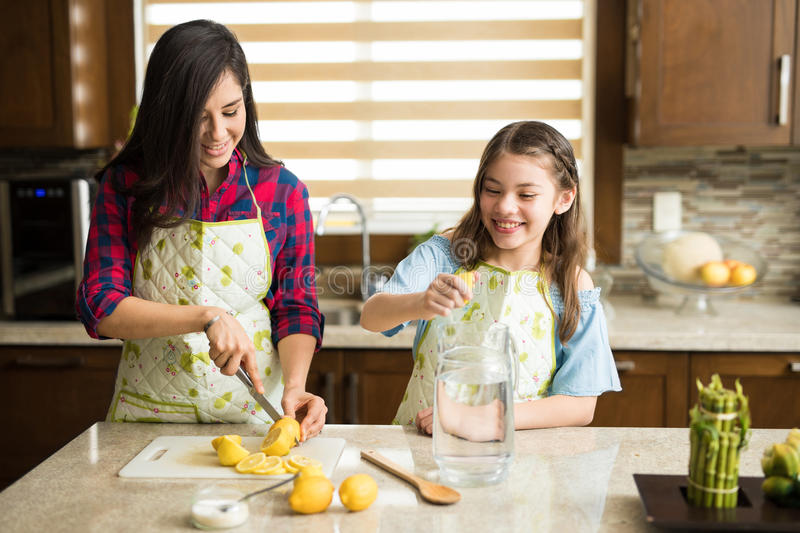 Single mom and daughter working as a team royalty free stock photos