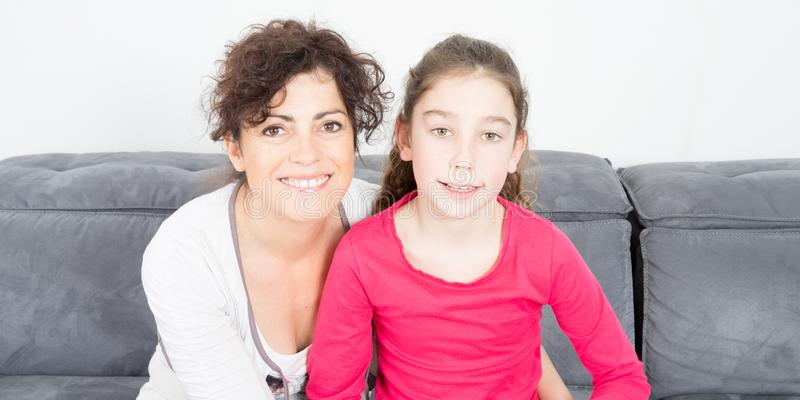 Mother diivorce with daughter in home sofa. Single mother diivorce with daughter in home sofa stock image