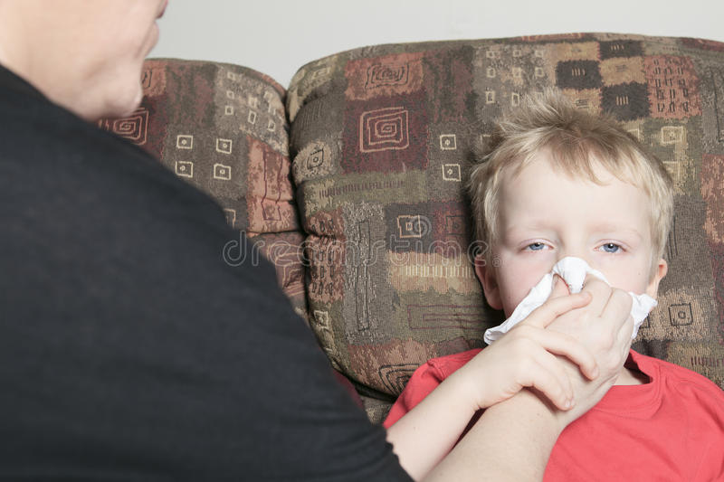 Single mother with son who suffers from a cold royalty free stock images