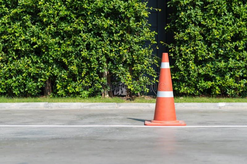 Single orange traffic cone on concrete street road royalty free stock photos