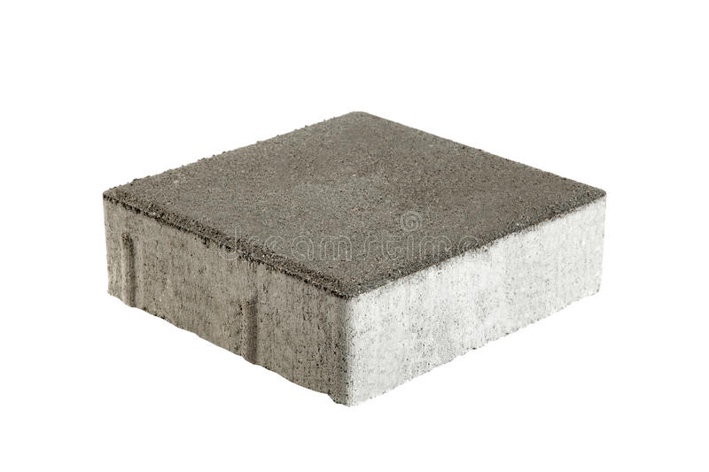 Single pavement brick, isolated. Concrete block for paving stock images
