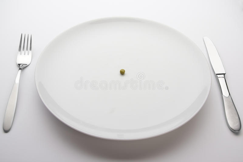 Download Single Pea On A Dinner Plate Stock Image - Image: 20007061