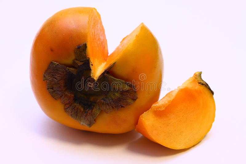 Single Persimmon Fruit (Diospyros kaki) chopped stock photo