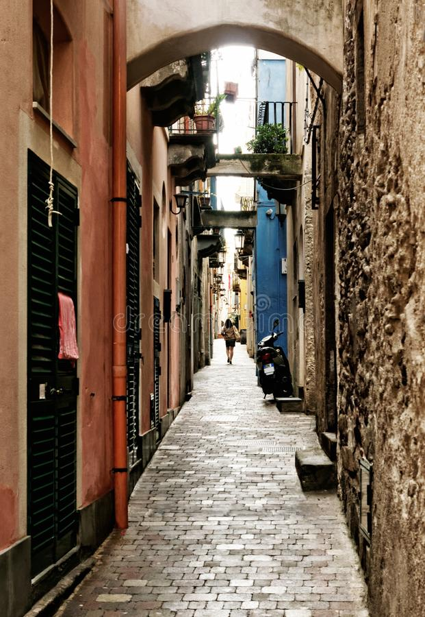 Single person in a long mediterranean alley royalty free stock photos