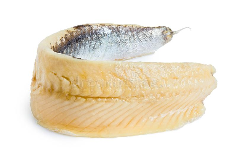 A single piece of anchovy fillet isolated on white stock image