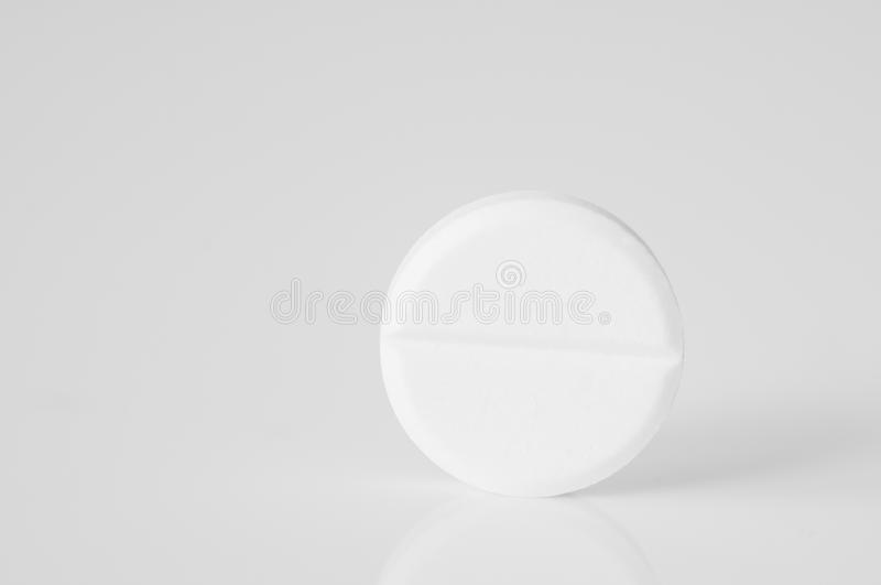 Single pill. On white background royalty free stock photography