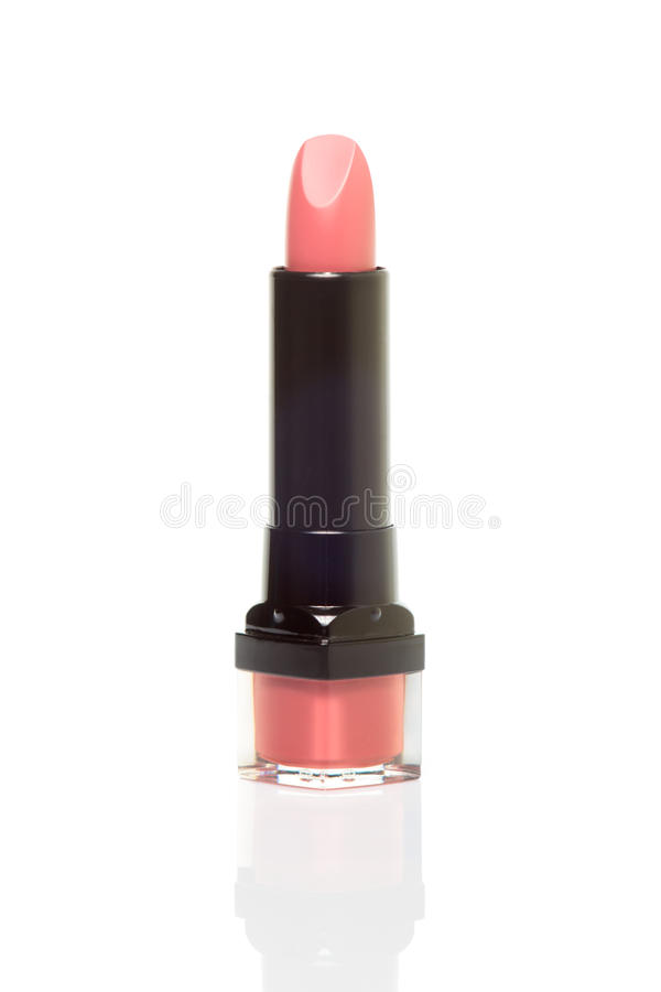Single pink lipstick isolated on white background stock image