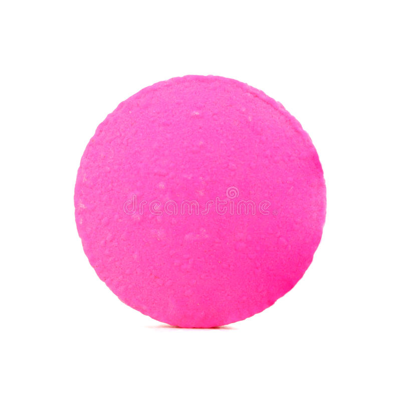 Single pink pill. On white background royalty free stock photos