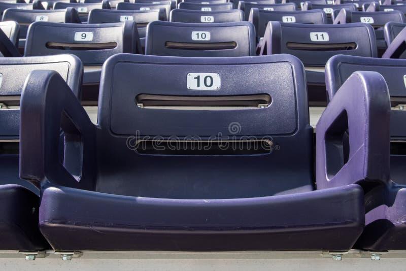 Single Purple Stadium Seat. In sports arena stock photo