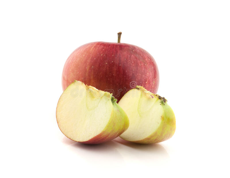 Single red apple with lobule. Isolated on white background royalty free stock photo