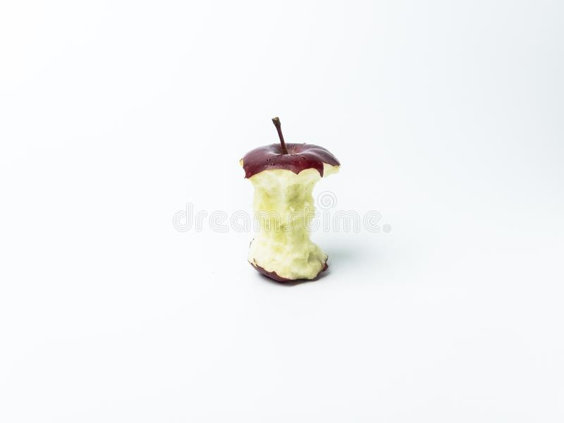 Single red apple with missing a bite isolate on white background royalty free stock photos
