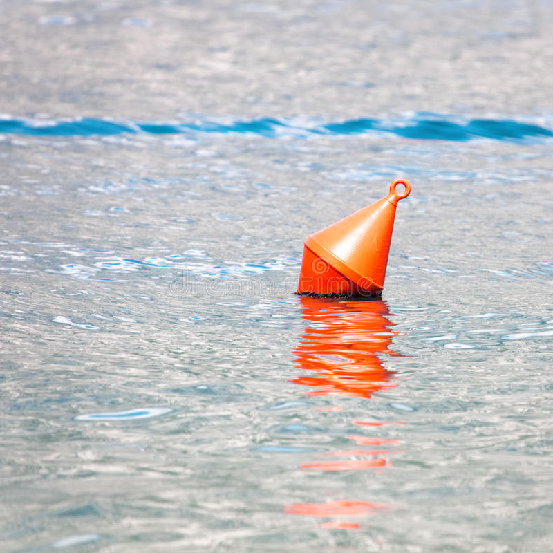 Single red buoy. On a calm sea surface stock photography