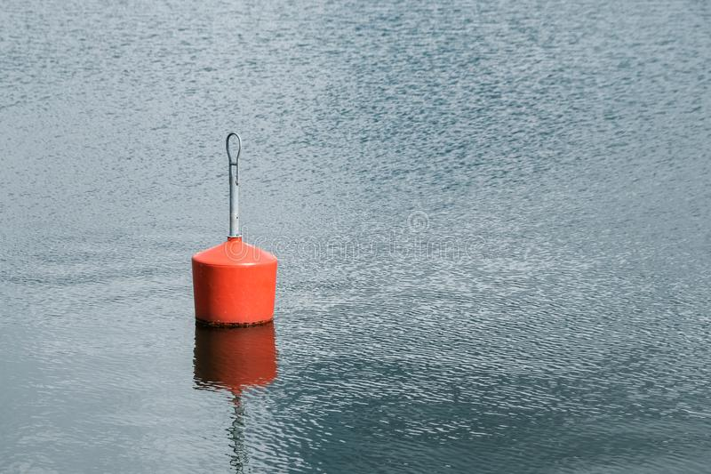 Single Red Buoy in Marina. Copy space royalty free stock photography